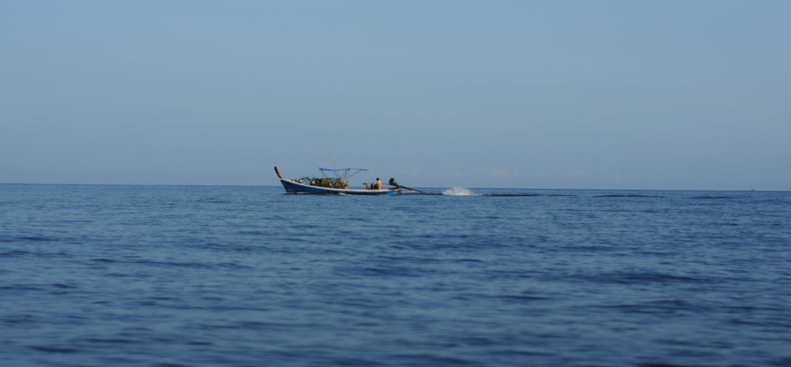 Longtail boat sailing on the sea